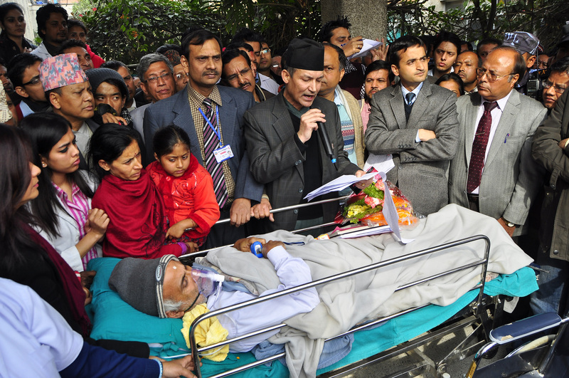 After an assurance that Prof Dr Prakash Sayami would be reinstated as the dean of Institute of Medicine following Dr Shashi Sharma's dismissal, senior orthopaedic surgeon Prof Dr Govinda KC is ending his 3rd hunger strike in Kathmandu. Image by Narayan Maharjan. Copyright Demotix (24/1/2014)