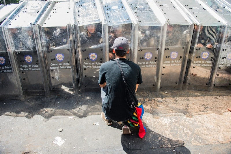 Students trying to persuade riot police in Caracas, Venezuela. Copyright Demotix. Photo by Carlos Becerra on 12 February 2014.