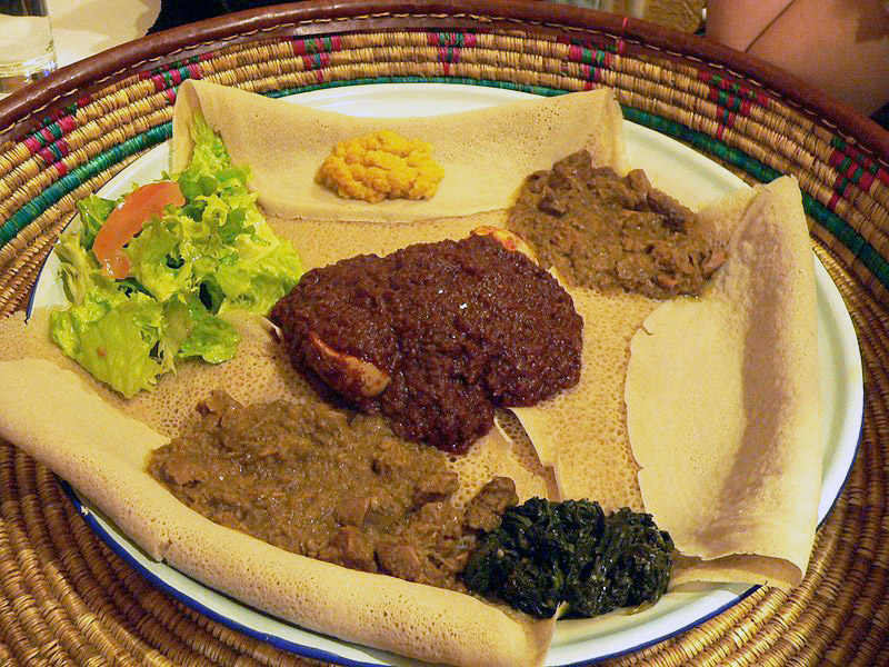 Ethiopian/Eritrean injera (flat bread), which can be eaten with dishes such as Doro wet. Photo released under Creative Commons by Wikipedia user Rama.