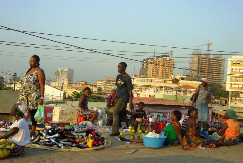 """For most of the inhabitants, the skyscrapers of Luanda mean nothing but a background."" Photo and caption by Ionut Sendroiu copyright Demotix (8 October 2010)"