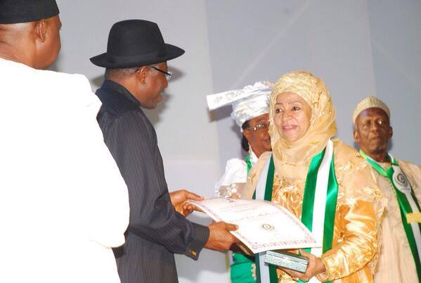 Former First Lady Maryam Abacha receiving the Nigeria Centenary Award for her deceased husband from President Jonathan [Image by Reuben Abati. Used with permission.]