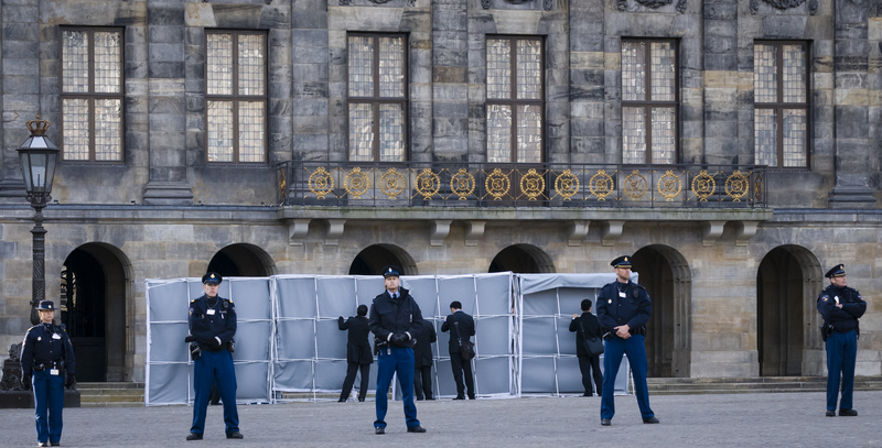 Shortly before the arrival of Chinese President Xi Jinping at the Royal Palace in Amsterdam on March 22, 2014, Chinese security officials erected screens to block the president's view of the protesters. Photo by Hans Knikman/Demotix.