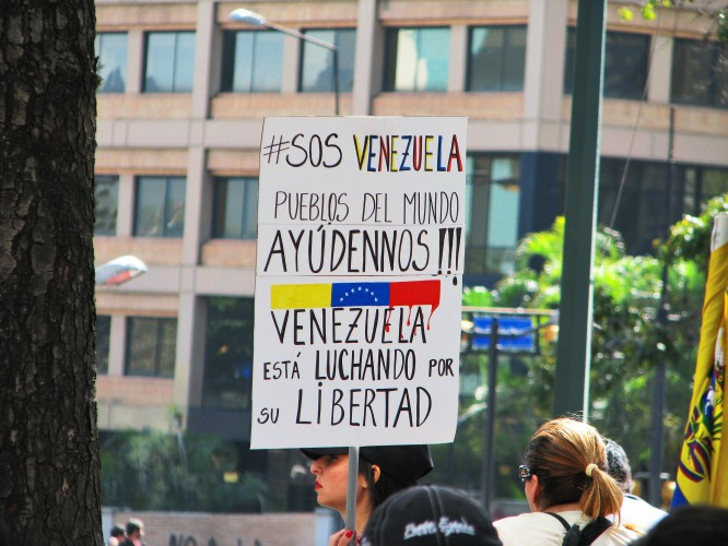 #SOSVenezuela. Photo by Kira Kariakin.