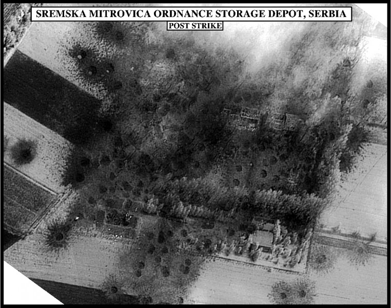 Post-strike bomb damage assessment photograph of the Sremska Mitrovica Ordnance Storage Depot, Serbia, used by Joint Staff Vice Director for Strategic Plans and Policy Maj. Gen. Charles F. Wald, U.S. Air Force, during a press briefing on NATO Operation Al. Image by United States Government, public domain.