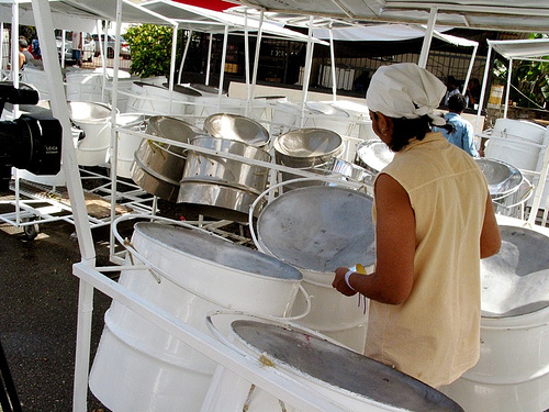 Pans being cleaned in preparation for a performance.  Image by caribbeanfreephoto, used under a CC license.