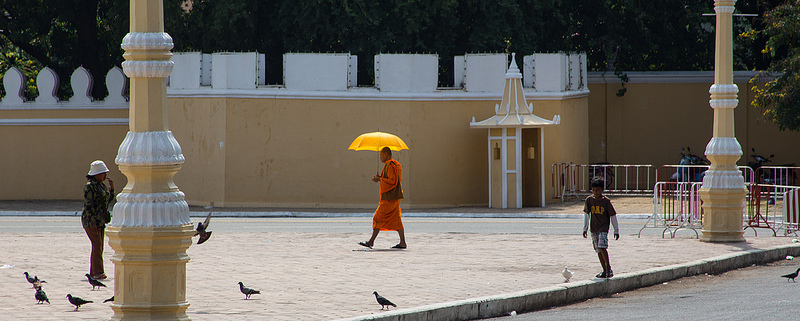 A monk walking in a community plaza
