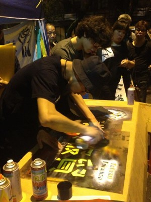 Students from Department of Motion Pictures and Video printed the slogans for the protesters. Photo from NTU News E-Form. CC: NC.