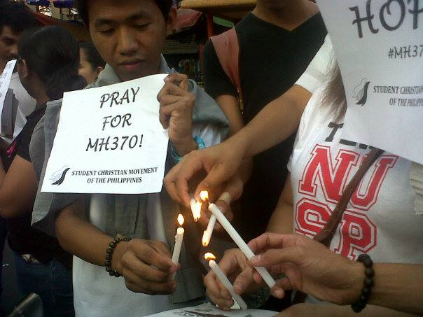 Filipino students hold a candle lighting ceremony in honor of passengers of MH370. Photo from Kathy Yamzon