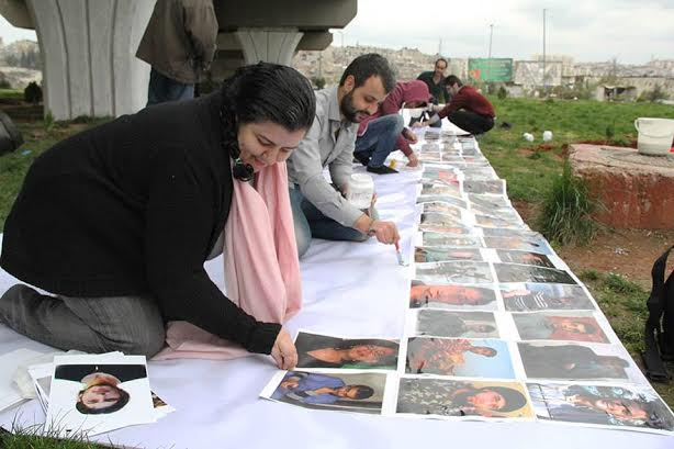 Marcell and friends preparing the martyrs memorial to commemorate the third anniversary of the Syrian revolution