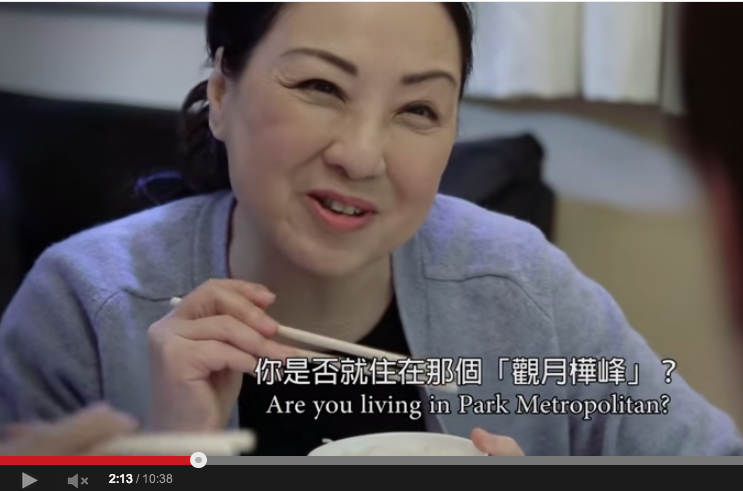 Angelina Lo, playing the mother in the video, is keen to know where exactly her daughter's boyfriend lives. Screen capture from YouTube.