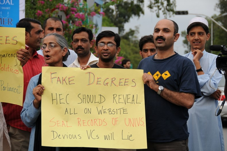 Pakistan Civil society activists protest against  fake degrees.  Image by Isa Daudpota. Copyright Demotix (20/07/2010)