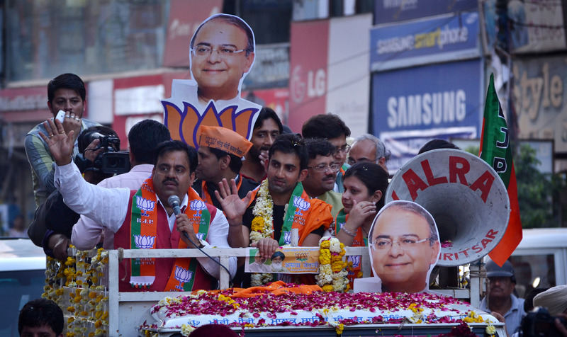 Indian cricketer Gautam Gambhir campaigns for BJP in Amritsar. Image by Sanjeev Syal. Copyright Demotix (5/4/2014)