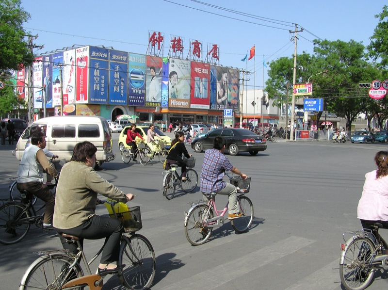 A busy intersection in downtown Baoding, China. Photo taken June 6, 2006 by Flickr user Tim Riley. CC BY-NC-ND 2.0