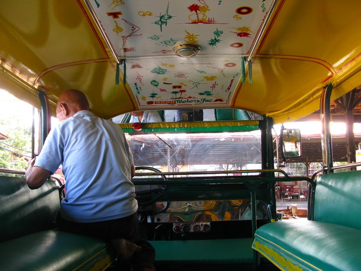 An artist paints inside a jeepney. Facebook photo from Sarao