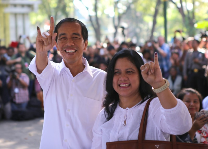 Jakarta Governor Joko Widodo and his wife cast their votes in the legislative elections in Jakarta. Photo by Denny Pohan, Copyright @Demotix (4/9/2014)