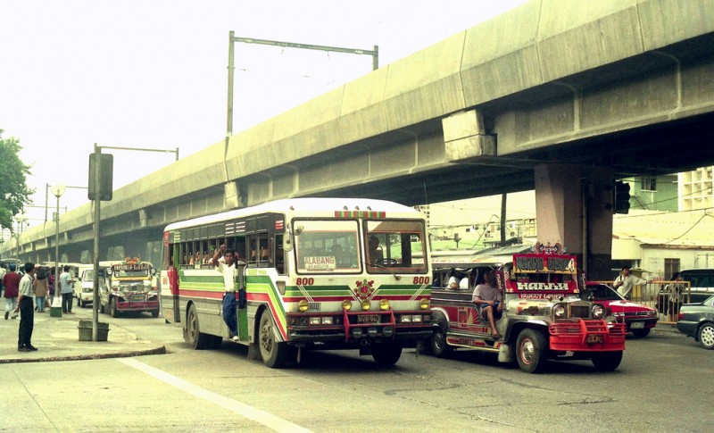 The main modes of transportation in Manila: Bus, Jeepney, LRT train. Flickr photo by John Ward (CC License)
