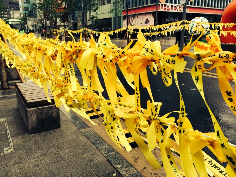 Yellow Ribbons tied by citizens, hoping for miracles, at one random street of Seoul, Image by author.
