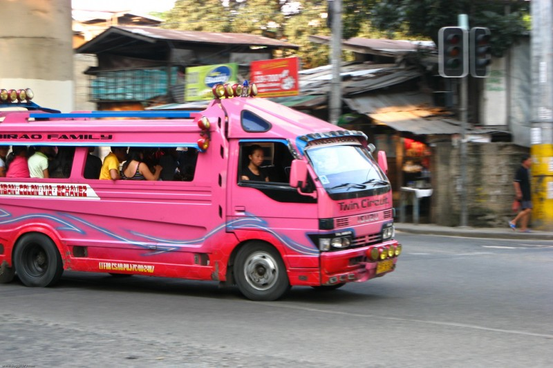 A pink jeepney with a different structural design. Flickr photo by dbgg1979 (CC License)
