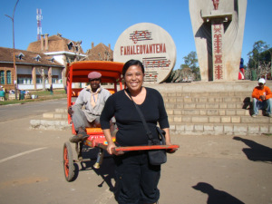 Ariniana posing with a rickshaw owner and his rickshaw in Antsirabe, Madagascar (with her permission)