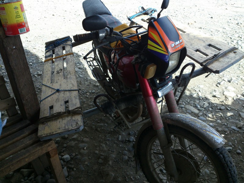 This Habal-Habal has extensions consisting of wooden planks across the seat of the motorcycle. Photo by Sherbien Dacalanio, Copyright @Demotix (9/8/2012)
