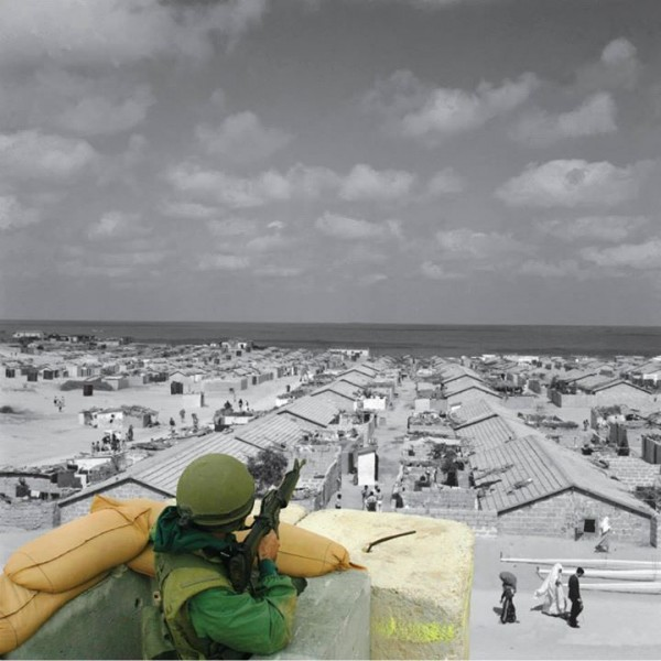 Beach refugee camp, Gaza Strip UNRWA photo archive.  An Israeli soldier at Qalandiya checkpoint. 20 Apr. 2002, by Alexandra Boulat
