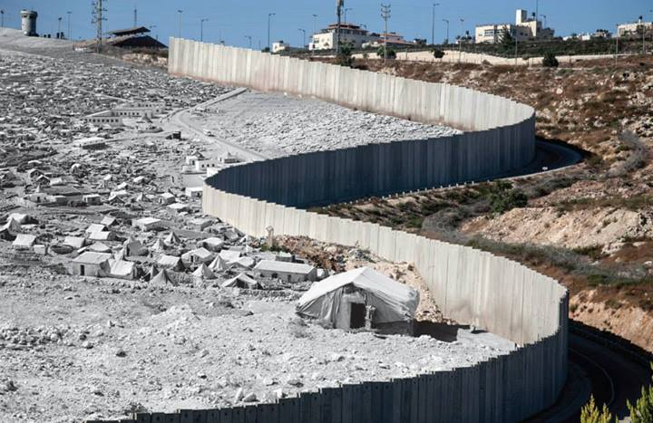 Dheisheh refugee camp, after the 1948 partition. UNRWA photo archive A segment of the Israeli separation wall near Beit Hanina,, Jerusalem 2012. by Tanya Habjouqa