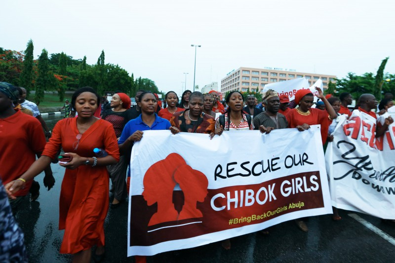 Protesters took to the streets in Abuja to demand urgent action from the government in finding the 200 school girls kidnapped in Chibok. Despite the heavy rain, they marched along. Photo by Ayemoba Godswill. Copyright Demotix (4/30/2014)