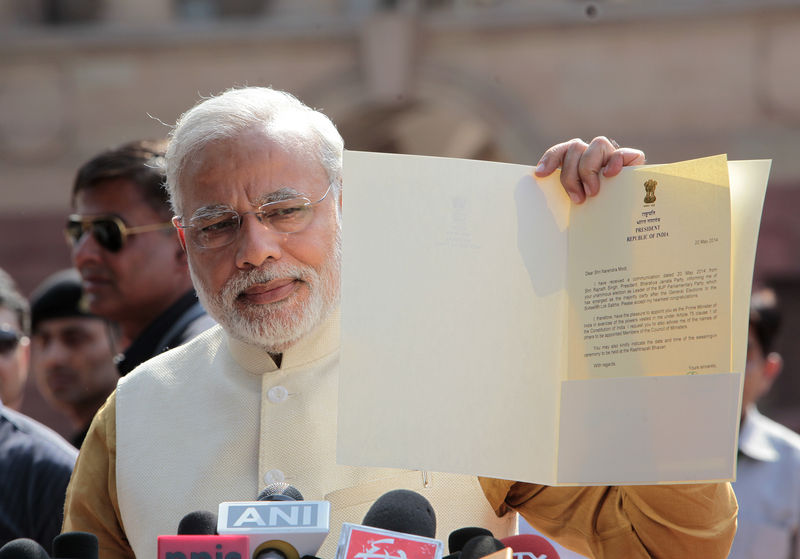 Narendra Modi talking to media showing the letter of President of India appointing him as Prime Minister of India. Image by Ranjan Basu. Copyright Demotix (20/5/2014)