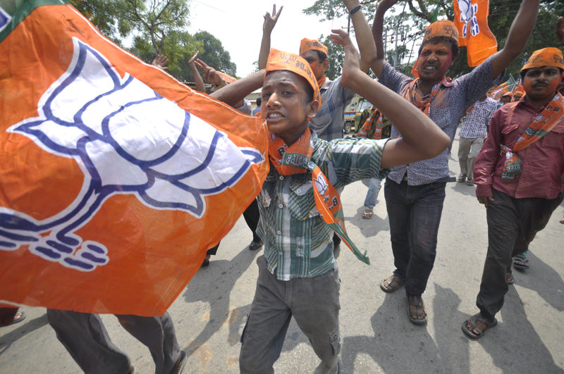 Bharatiya Janata Party (BJP) supporters were dancing in the streets to celebrate the win of the BJP. Image by Abhisek Saha. Copyright Demotix (21/05/2014)
