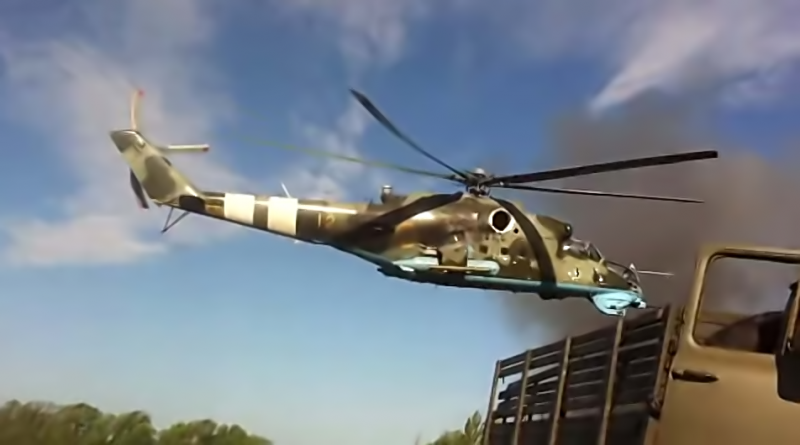 A Ukrainian military helicopter flying over Ukrainian regular troops in the Donetsk region. YouTube screenshot.