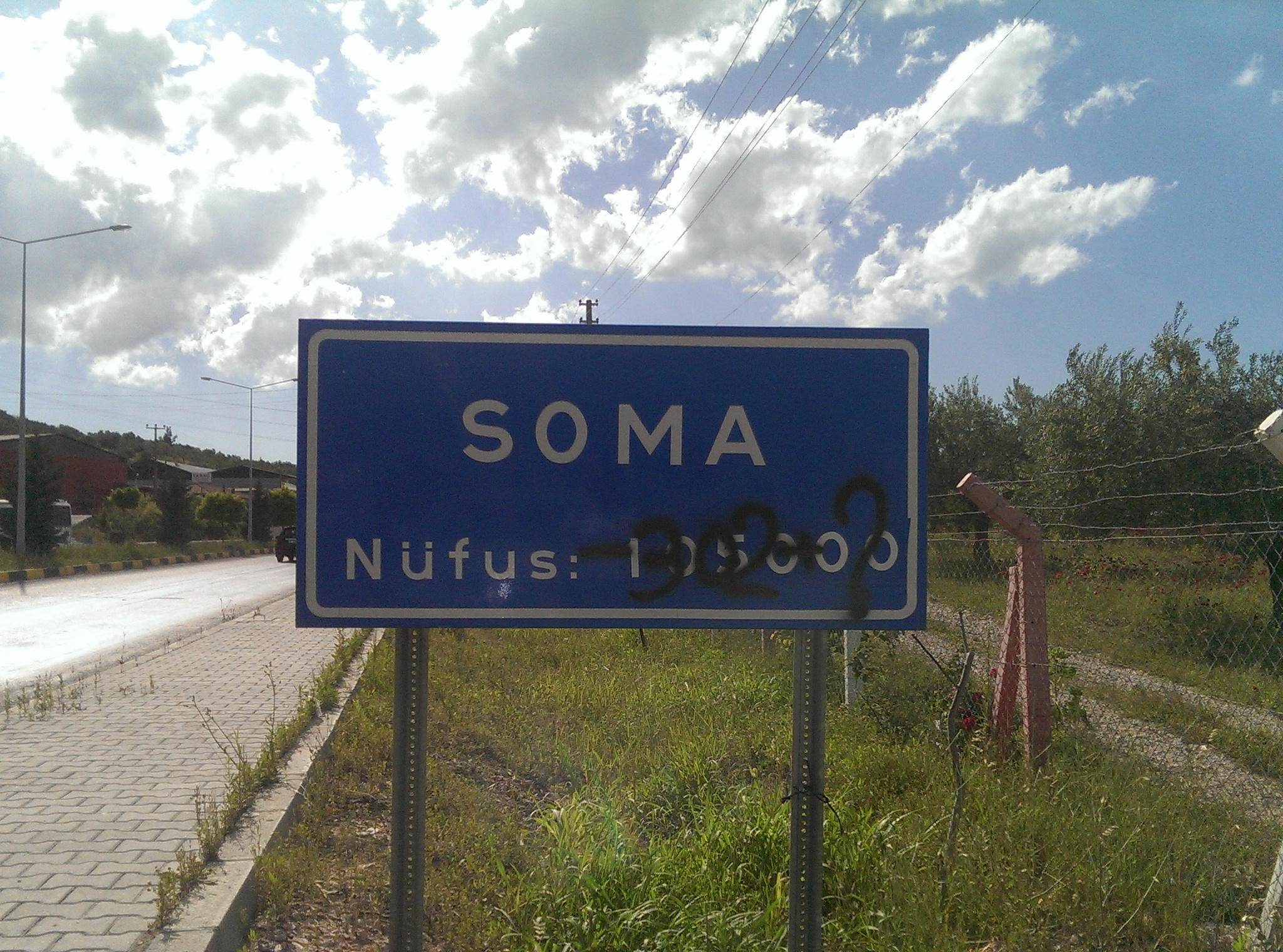 "Photo by Cansın Leylim Ilgaz. ""SOMA Population 105000"", ""-302?"" in graffiti in remembrance of those lost in the coal mine."