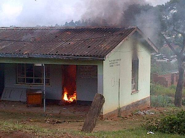 A polling centre in Malawi burns. Photo by Albert Sharra. Used with permission.