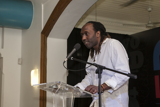 "Kei Miller, reading from his work ""Writing Down the Vision"". Photo my Marlon James, used with permission."