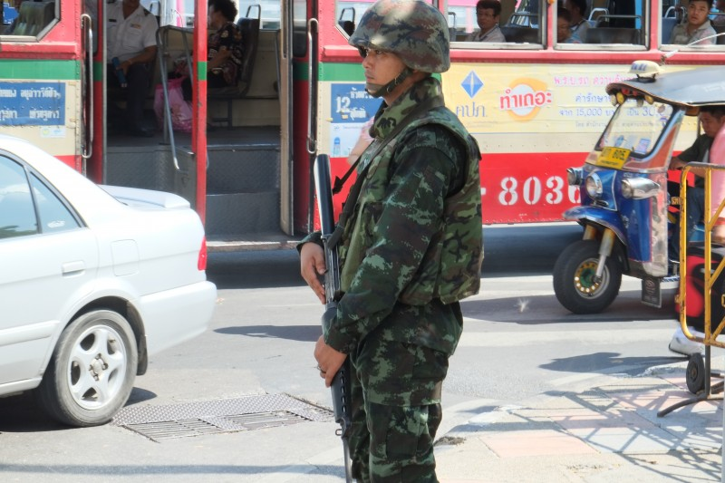 A Thai soldier stands guard on Ratchadamnoern Avenue in central Bangkok. Photo by Matthew Richards, Copyright @Demotix (5/22/2014)