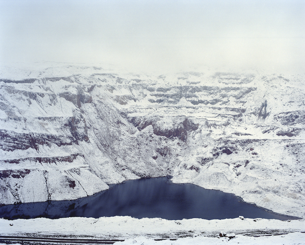 A quarry filled with water from melting snow in the Nookat region of Kyrgyzstan.