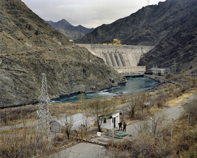 Military officers guard the entrance to the Kambaratinsk Dam on the Naryn River. The Kambar-Ati-1 Hydro Power Plant at the base of the dam, largely financed through a $2 billion Russian aid package, will have a capacity of approximately 1,900 megawatts.