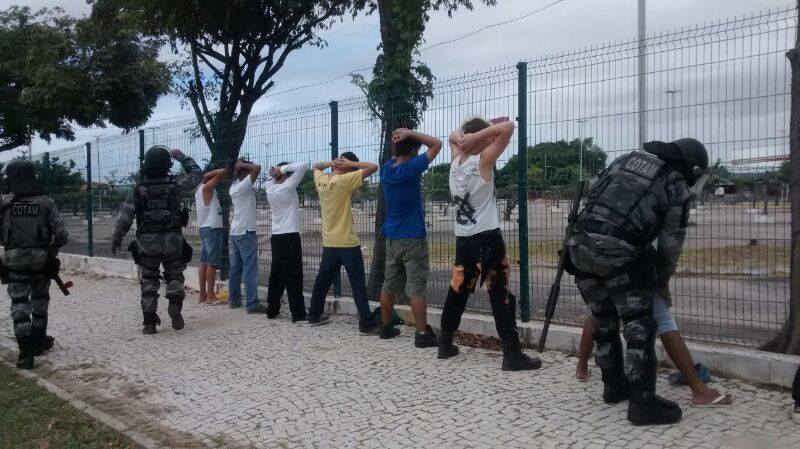 Heavily armed and unidentified police officers search protesters in Fortaleza before the game. Photo shared by platform Na Rua on Facebook.