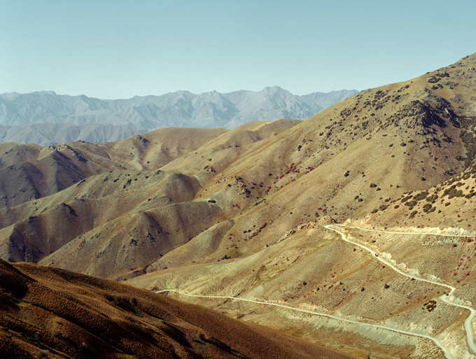 View of the road through Kyrgyzstan's Kalmak-Ashu Pass, which is more than two miles above sea level.