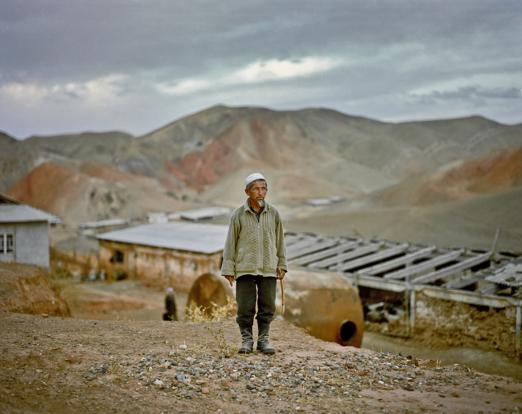 Kurambaev Almaz, 69, lives with his wife more than 100 miles away from the nearest town in Kyrgyzstan's Osh Province. Almaz travels by donkey into the mountains to find drinking water. Photo by Fyodor Savintsev / Salt Images, 2008.