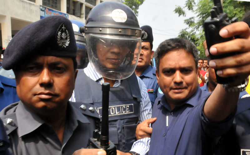 Law enforcers take former Rab official Lt. Col. Tareque Sayeed the Senior Judicial Magistrate court in Narayanganj. Image by Indrajit Ghosh. Copyright Demotix (17/5/2014)