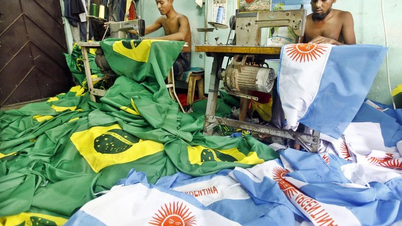 Tailors sew Brazil and Argentina flags at a shop in Dhaka ahead of the World Cup.  Image by Rohit Rajib. Copyright Demotix (21/5/2014)