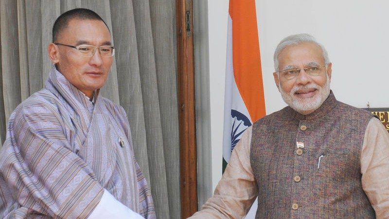 Newly sworn-in Prime Minister Narendra Modi (R) shakes hands with Bhutan Prime Minister Tshering Tobgay during a meeting in New Delhi. Image by Amit Kumar. Copyright Demotix (27/5/2014)