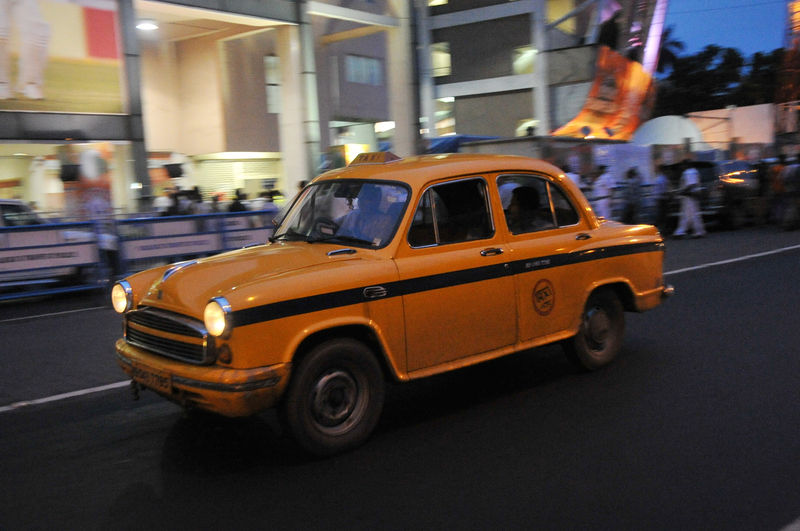 A yellow Hindustan  ambassador taxi at Kolkata Road. Image by D Chakraborty. Copyright Demotix (27/5/2014)