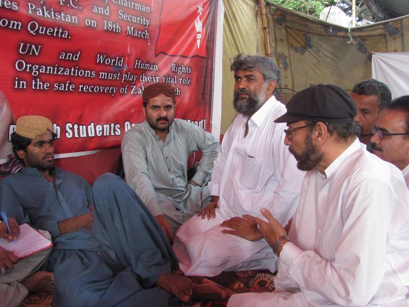 Members of civil society visits the hunger strike camp of Lateef Johar protesting for the missing student leader Zahid Baluch from Quetta. Image by Ayub Mohammad. Copyright Demotix (31/5/2014)
