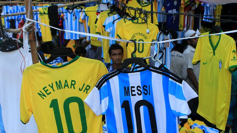 Traders are out to make some quick money as the sale of jerseys of various countries soar ahead of the FIFA World Cup in Brazil. Image by Md. Manik. Copyright Demotix (5/6/2014)