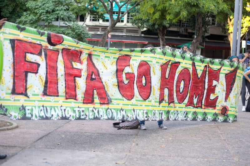 "A banner reads ""FIFA go home"" during a protest in Rio de Janeiro against the hosting of the 2014 FIFA World Cup in Brazil. June 15, 2014. Photo by Nicson Olivier. Copyright Demotix."