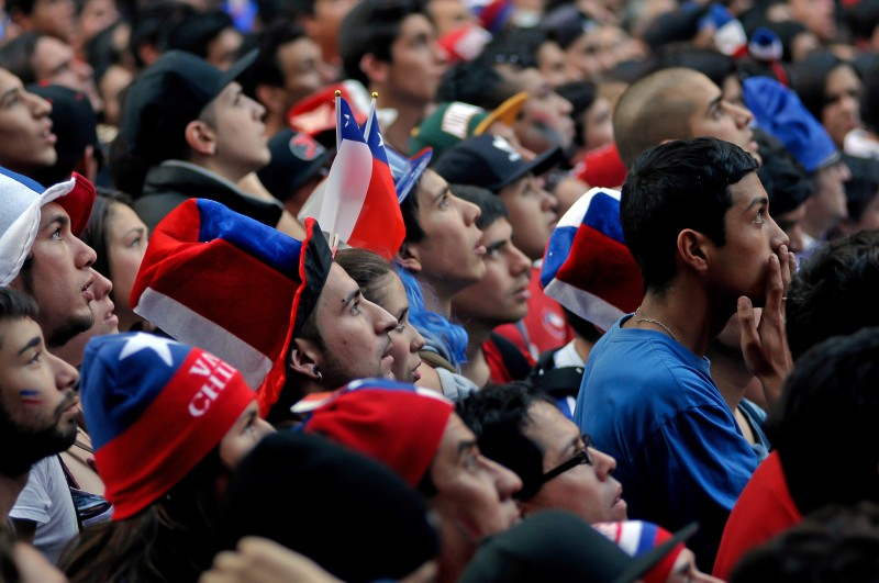 Thousands of people gathered in the center of Santiago to party after Chile beat Spain 2-0 in their Group B FIFA World Cup match. Photo by Fernando Lavoz. Copyright Demotix.