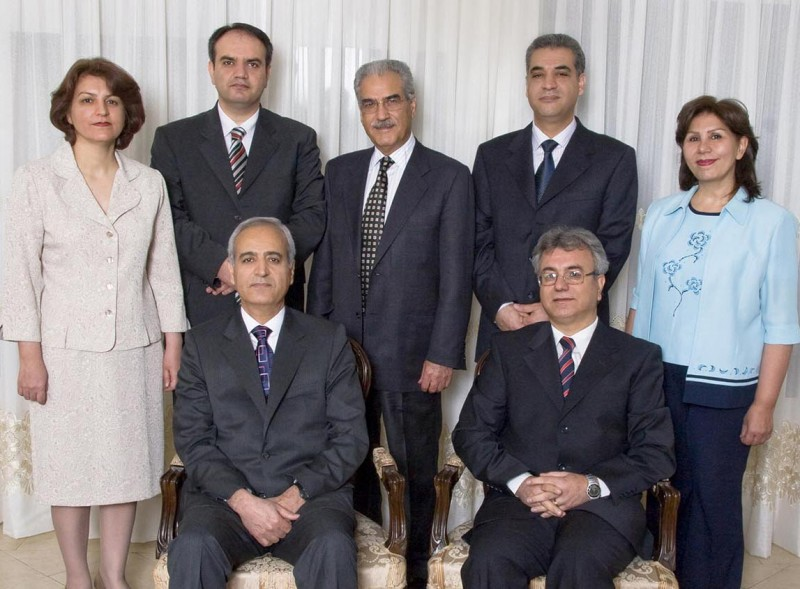 The seven Baha'i leaders arrested in 2008 are, seated from left, Behrouz Tavakkoli Saeid Rezaie, and, standing, Fariba Kamalabadi, Vahid Tizfahm, Jamaloddin Khanjani, Afif Naeimi, and Mahvash Sabet. The photograph was taken several months before their arrest. Photo credit: Bahá'í International Community United Nations Office