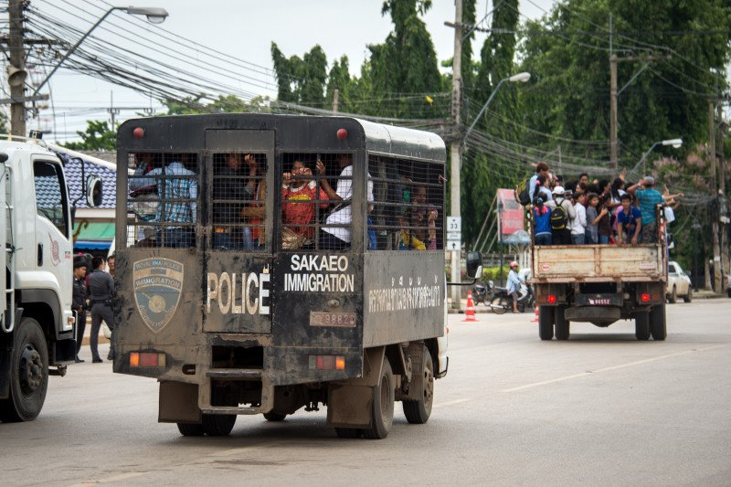 Cambodians are transported to the border from Aranyaprathet, Thailand, the last town before the border near Cambodia. Photo by Lee Craker, Copyright @Demotix (6/17/2014)