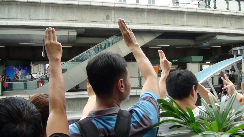 Anti Coup protesters raise their hands in a three finger salute as a symbol of struggle. Photo by Gonzalo Abad, Copyright @Demotix (6/1/2014)